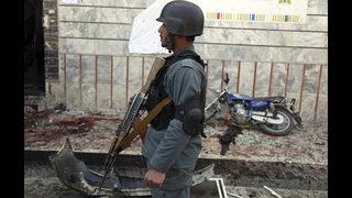 Afghan officials: Taliban attacks kill 14 troops, policemen