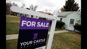 FILE- In this March 28, 2018, file photo, a for sale sign is shown outside a single-family home on the market in Denver. On Monday, April 23, the National Association of Realtors reports on March sales of existing homes. (AP Photo/David Zalubowski, File)