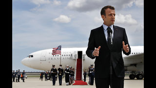 The Latest: French president goes for a walk along Penn Ave