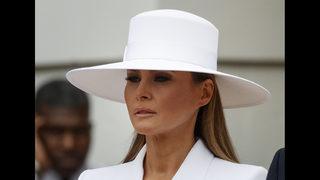 First lady Melania Trump greets the Macrons with a hat