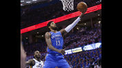 Oklahoma City Thunder forward Paul George (13) shoots in front of Utah Jazz forward Jae Crowder, left, during the first half of Game 5 of an NBA basketball first-round playoff series in Oklahoma City, Wednesday, April 25, 2018. (AP Photo/Sue Ogrocki)