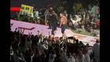 """World Wrestling Entertainment star John Cena is greeted by fans during the """"Greatest Royal Rumble"""" event in Jiddah, Saudi Arabia, Friday, April 27, 2018. A previous WWE event held in the ultraconservative kingdom in 2014 was for men only. But Friday night's event in Jiddah included both women and children in attendance. (AP Photo/Amr Nabil)"""