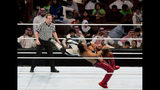 """World Wrestling Entertainment stars AJ Styles, top, and Shinsuke Nakamura, wrestle during their match at the """"Greatest Royal Rumble"""" event in Jiddah, Saudi Arabia, Friday, April 27, 2018. A previous WWE event held in the ultraconservative kingdom in 2014 was for men only. But Friday night's event in Jiddah included both women and children in attendance. (AP Photo/Amr Nabil)"""