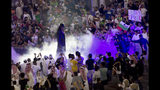 """World Wrestling Entertainment star The Undertaker is greeted by fans during a match of the """"Greatest Royal Rumble"""" event in Jiddah, Saudi Arabia, Friday, April 27, 2018. A previous WWE event held in the ultraconservative kingdom in 2014 was for men only. But Friday night's event in Jiddah included both women and children in attendance. (AP Photo/Amr Nabil)"""