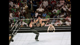 """World Wrestling Entertainment star The Undertaker, left, wrestles Rusev during their match of the """"Greatest Royal Rumble"""" event in Jiddah, Saudi Arabia, Friday, April 27, 2018. A previous WWE event held in the ultraconservative kingdom in 2014 was for men only. But Friday night's event in Jiddah included both women and children in attendance. (AP Photo/Amr Nabil)"""