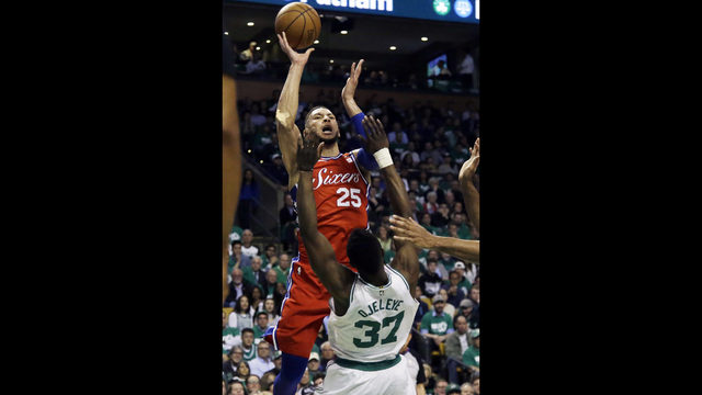b8c1643a8 Philadelphia 76ers guard Ben Simmons (25) goes up for a shot and is called  for a charge against Boston Celtics forward Semi Ojeleye (37) in the first  ...