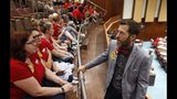 Arizona state Rep. Ken Clark, D-Phoenix, right, meets with teachers in the Arizona House of Representatives gallery during continued protests at the Arizona Capitol Thursday, May 3, 2018, in Phoenix. After an all night legislative budget session the legislature passed the new education spending portion of the budget and Republican Gov. Doug Ducey signed that part of the budget. (AP Photo/Ross D. Franklin)