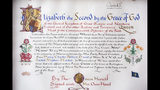 The 'Instrument of Consent', which is the Queen's historic formal consent to Prince Harry's forthcoming marriage to Meghan Markle, photographed at Buckingham Palace in London, Friday May 11, 2018. Britain's Queen Elizabeth II signed, top right, the Instrument of Consent, her formal notice of approval for the wedding in elaborate calligraphic script issued under the Great Seal of the Realm. The Succession to the Crown Act 2013, requires the first six people in the line of succession to the throne, to obtain the Queen's permission to marry.(Victoria Jones/Pool via AP)