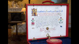 The 'Instrument of Consent', which is the Queen's historic formal consent to Prince Harry's forthcoming marriage to Meghan Markle, photographed at Buckingham Palace in London, Friday May 11, 2018. Britain's Queen Elizabeth II signed, top right, the Instrument of Consent, her formal notice of approval for the wedding in elaborate calligraphic script issued under the Great Seal of the Realm.(Victoria Jones/Pool via AP)