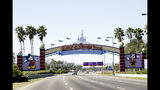 FILE- In this Jan. 31, 2017, file photo, cars travel one of the roads leading to Walt Disney World in Lake Buena Vista, Fla. A regional director of the National Labor Relations Board last week ruled that about 60 drivers who pick up Disney World guests using the Lyft app can be represented by the Teamsters local in Orlando. The Lyft drivers are Disney World employees who earn extra money by driving guests around the resort that is roughly the size of the city of San Francisco. (AP Photo/John Raoux, File)