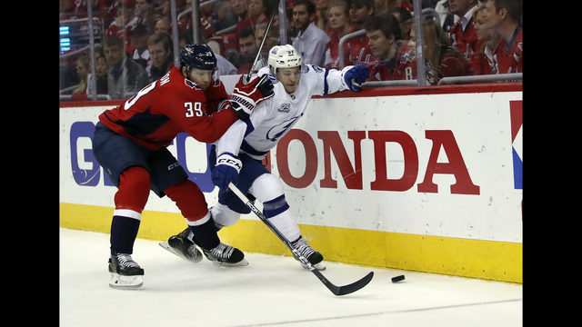 3cd22bbe37b Washington Capitals right wing Alex Chiasson (39) and Tampa Bay Lightning  center Yanni Gourde (37) battle for the puck during the first period of  Game 3 of ...