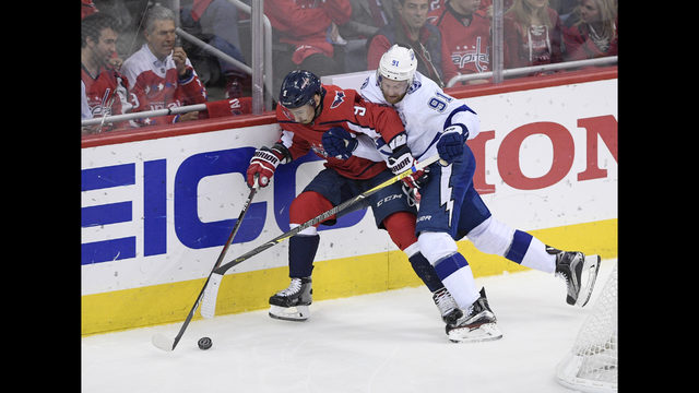 b45af26e5ab Tampa Bay Lightning center Steven Stamkos (91) battles for the puck against Washington  Capitals defenseman Dmitry Orlov (9)