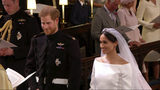In this frame from video, Britain's Prince Harry and Meghan Markle stand during their wedding ceremony at St. George's Chapel in Windsor Castle in Windsor, near London, England, Saturday, May 19, 2018. (UK Pool/Sky News via AP)