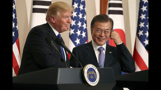 Moon enters talks with Trump with driver