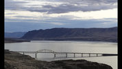 This Feb. 14, 2018 photo shows the Vantage Bridge, which carries Interstate Highway 90 across the Columbia River near Vantage, Wash., at dusk. Talks are scheduled to begin Tuesday, May 29, 2018, in Washington, D.C., to modernize the document that coordinates flood control and hydropower generation in the U.S. and Canada along the Columbia River. (AP Photo/Ted S. Warren)