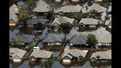 FILE - In this Friday, Sept. 1, 2017 file photo, homes are surrounded by water from the flooded Brazos River in the aftermath of Hurricane Harvey in Freeport, Texas. According to a study released on Wednesday, June 6, 2018, tropical cyclones around the world are moving slightly slower over land and water, dumping more rain as they stall, just as Hurricane Harvey did. (AP Photo/Charlie Riedel)