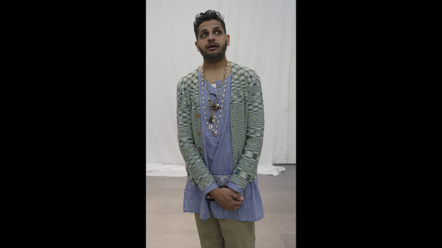 635f039abfab Missoni s head designer Mayur Ghadialy talks to the Associated Press  reporter as he presents the Missoni men s Spring-Summer 2019 collection