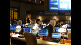 FILE - In this Thursday, June 14, 2018, file photo, bettors wait to make wagers on sporting events at the Borgata casino in Atlantic City, N.J., hours after it began accepting sports bets. The Borgata casino in Atlantic City and Monmouth Park racetrack in Oceanport, near the Jersey shore, are the only two outlets offering sports betting in the state since it became legal in June 2018. (AP Photo/Wayne Parry, File)
