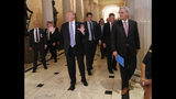 President Donald Trump, left, stops to make comments to members of the media as he walks with House Majority Leader Kevin McCarthy of Calif., right, while leaving the U.S. Capitol in Washington after meeting with Republican leadership, Tuesday, June 19, 2018. (AP Photo/Pablo Martinez Monsivais)