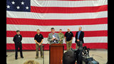 "FILE - In this Thursday, May 31, 2018, file photo, Salem city manager Steve Powers speaks to reporters along with state and city officials at a National Guard depot in Salem, Ore., after Gov. Kate Brown announced she was deploying the National Guard to deliver water to residents of the state's capital city. The words blasted to cellphones around Salem were ominous: ""Civil emergency… prepare for action."" Within half an hour, a second official alert clarified the subject wasn't impending violence, but toxins from an algae bloom, detected in the city's water supply. (AP Photo/Tom James, File)"
