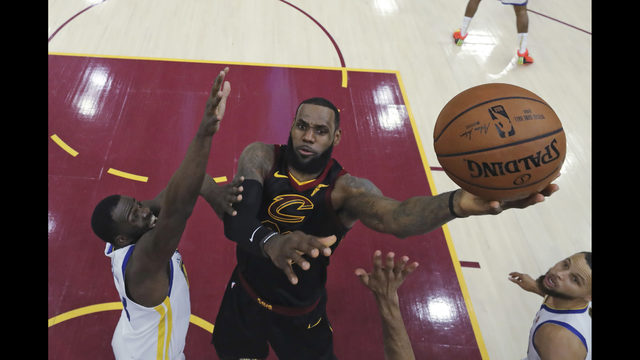 2015ad56753 LeBron agrees to 4-year