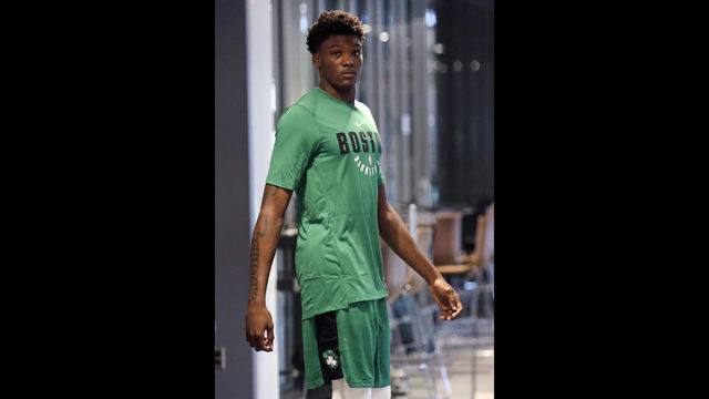 79c672a60 Boston Celtics draft pick Robert Williams arrives for a news conference at  the team s training facility in Boston