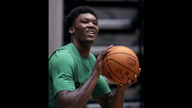 f85e87114 Boston Celtics NBA basketball team draft pick Robert Williams smiles while  lining up a shot at the team s training facility in Boston