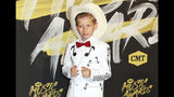 FILE - In this June 6, 2018, file photo, Mason Ramsey arrives at the CMT Music Awards at the Bridgestone Arena in Nashville, Tenn. Ramsey, a preteen Illinois boy who went viral online in a video of him singing and yodeling in a Walmart store is releasing his first album July 20. (AP Photo/Al Wagner, File)