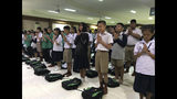 Students pray at Maesaiprasitsart school where six out of the rescued 12 boys study as they cheer the successful rescue in the Mae Sai district in Chiang Rai province, northern Thailand, Wednesday, July 11, 2018. A daring rescue mission in the treacherous confines of a flooded cave in northern Thailand has saved all 12 boys and their soccer coach who were trapped deep within the labyrinth, ending a grueling 18-day ordeal that claimed the life of an experienced volunteer diver and riveted people around the world. (AP Photo/Johnson Lai)