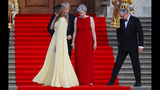 First lady Melania Trump, left, walks past President Donald Trump, British Prime Minister Theresa May, and May's husband Philip May, during the arrival ceremony at Blenheim Palace, Oxfordshire, Thursday, July 12, 2018. (AP Photo/Pablo Martinez Monsivais)