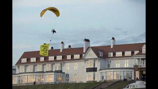 Paraglider charged in Trump resort flight; Finns demonstrate