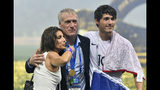 France head coach Didier Deschamps, center, celebrates with his son Dylan and his wife Claude, left, after France won 4-2 during the final match between France and Croatia at the 2018 soccer World Cup in the Luzhniki Stadium in Moscow, Russia, Sunday, July 15, 2018. (AP Photo/Martin Meissner)