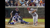 Los Angeles Angels of Anaheim outfielder Mike Trout (27) hits a solo home run in the third inning during the 89th MLB baseball All-Star Game, Tuesday, July 17, 2018, at Nationals Park, in Washington. (AP Photo/Carolyn Kaster)