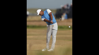 The Latest: Zach Johnson the clubhouse leader in Open