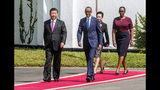 Rwandan President Paul Kagame, right, and Chinese President Xi Jinping, followed by their wives Jannette Kagame and Peng Liyuan arrive at Rwanda's State House on Monday, July 23, 2018. Xi is on a two-day state visit to Rwanda (AP Photo)