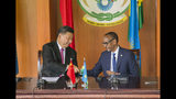 """China's President Xi Jinping, left, shakes hands with Rwanda's President Paul Kagame during a press conference at State House, in Kigali, Rwanda, Monday, July 23, 2018. Kagame is praising China's treatment of Africa """"as an equal,"""" calling it """"a revolutionary posture in world affairs."""" (AP Photo)"""