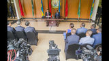 """China's President Xi Jinping, left, sits at a table with Rwanda's President Paul Kagame during a press conference at State House, in Kigali, Rwanda, Monday, July 23, 2018. Kagame is praising China's treatment of Africa """"as an equal,"""" calling it """"a revolutionary posture in world affairs."""" (AP Photo)"""
