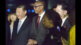President Paul Kagame of Rwanda, center, greets President Xi Jinping of China, center left, after his arrival or a two day state visit in Kigali, Rwanda Sunday, July 22, 2018. President Xi will hold bilateral talks with President Paul Kagame. (AP Photo)