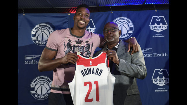 7aed23e6cb2 Washington Wizards recently acquired center Dwight Howard poses for a photo  with his father Dwight Howard, Sr., during a news conference in Washington,  ...