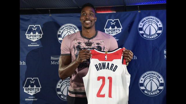 48eb8b3fff8 Washington Wizards recently acquired center Dwight Howard poses for a photo  during a news conference in Washington, Monday, July 23, 2018.
