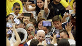 Pope Francis is cheered by faithful as he arrives in the Paul VI hall at the Vatican for his the weekly general audience, Wednesday, Aug. 1, 2018. AP Photo/Gregorio Borgia)