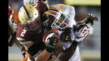 FILE - In this Oct. 7, 2017, file photo, Boston College's Zach Allen (2) tackles Virginia Tech's Travon McMillian during the second half of an NCAA college football game in Boston. In college football's year of the defensive lineman, Allen is not getting the publicity of Clemson's four potential first-round draft picks, the latest Bosa harassing quarterbacks at Ohio State or Houston's Ed Oliver. With an obsessive dedication to an early-to-bed-early-too-rise routine and strict diet of George Foreman Grill meals, Allen has put himself on the same level as all those former five-star prospects. (AP Photo/Michael Dwyer)
