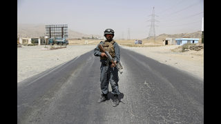 The Latest: Afghan officials: Taliban attack kills 30 troops