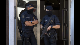 The Latest: Barcelona police shoot knife attacker dead