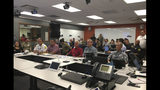 In this photo provided City and County of Honolulu, Mayor Kirk Caldwell, center, receives a briefing from the Central Pacific Hurricane Center on Hurricane Lane at the Emergency Operations Center in Honolulu, Tuesday, Aug. 21, 2018. The National Weather Service has issued a hurricane watch for parts of Hawaii. Senior Honolulu forecaster Tom Birchard says the watch for Hurricane Lane has been issued for the island of Hawaii and Maui County, which includes the island of Maui and other smaller islands. (Andrew Pereira/City and County of Honolulu via AP)