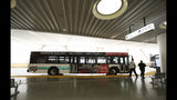 In this photo taken Wednesday, Aug. 15, 2018, a bus sits on the third floor of the new Transbay Transit Center in San Francisco. The new $2.2 billion center opened earlier this month. (AP Photo/Lorin Eleni Gill)