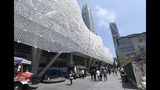 In this photo taken Wednesday, Aug. 15, 2018, food trucks beckon workers outside the new Transbay Transit Center in San Francisco. The new $2.2 billion center opened earlier this month. (AP Photo/Lorin Eleni Gill)