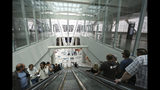 In this photo taken Wednesday, Aug. 15, 2018, visitors ride the escalators inside the new Transbay Transit Center in San Francisco. The new $2.2 billion center opened earlier this month. (AP Photo/Lorin Eleni Gill)