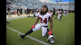 FILE - In this Aug. 25, 2018, file photo, Atlanta Falcons running back Devonta Freeman (24) stretches during warmups before an NFL preseason football game against the Jacksonville Jaguars, in Jacksonville, Fla. Freeman struggled through an injury plagued season that included two concussions and a sprained right knee. With all signs that his knee is healthy, Freeman is eager to reclaim the form that made him the NFL's highest-paid running back.(AP Photo/Phelan M. Ebenhack, File)