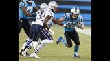 """File- This Aug. 24, 2018, file photo shows Carolina Panthers' Christian McCaffrey (22) running as New England Patriots' Devin McCourty (32) defends during the first half of a preseason NFL football game in Charlotte, N.C. Coach Ron Rivera has made it clear McCaffrey will play a huge role for Carolina, saying that it would be """"ideal"""" to get the second-year running back 25 to 30 touches per game. McCaffrey averaged less than half of that amount of touches last season and still managed 1,086 yards from scrimmage and seven total touchdowns, so there is a potential for him to have a big year. (AP Photo/Mike McCarn, File)"""